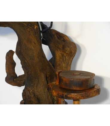 Candle holder formed of a tree root and an old butter churn